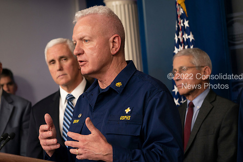United States Assistant Secretary for Health Admiral Brett P. Giroir speaks during a news briefing on coronavirus at the White House in Washington, DC on Sunday, March 15, 2020.  Looking on at left is US Vice President Mike Pence and at right is Director of the National Institute of Allergy and Infectious Diseases at the National Institutes of Health Dr. Anthony Fauci.<br /> Credit: Chris Kleponis / Pool via CNP