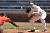 First baseman Austin Stadler #9 of the Wake Forest Demon Deacons waits for a pick-off throw versus the Virginia Cavaliers at Wake Forest Baseball Park March 8, 2009 in Winston-Salem, NC. (Photo by Brian Westerholt / Four Seam Images)