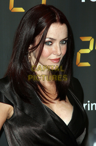 "ANNIE WERSCHING .Arrivals for the SPRINT- sponsored New York Premiere Screening for Season Eight of ""24"", New York, NY, USA, .14th January 2010.. 8 portrait headshot black gold hoop earrings wrap silk satin cleavage profile .CAP/ADM/PZ.©Paul Zimmerman/Admedia/Capital Pictures"
