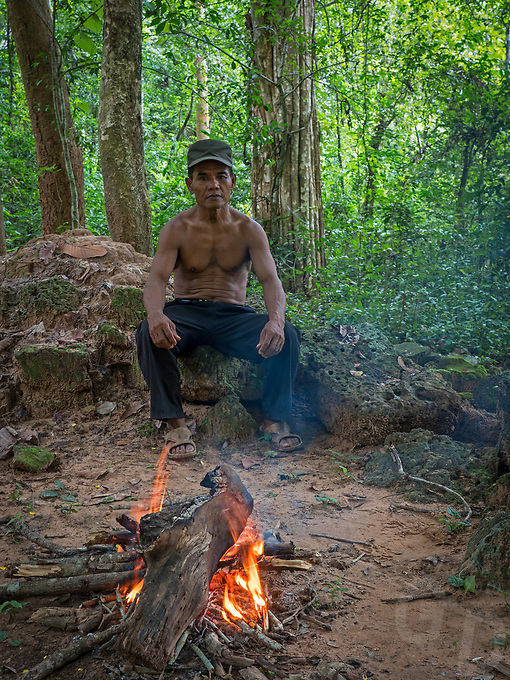 A proud Khmer worker at his camp site in the Jungle near Preah Khan. He was one of a group of workers who clear some of the undergrowth at a nearby temple away from the Tourist path. Cambodia