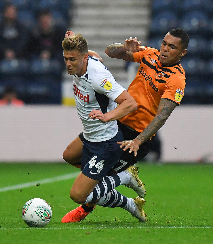 Preston North End's Brad Potts is tackled by Hull City's Josh Magennis<br /> <br /> Photographer Dave Howarth/CameraSport<br /> <br /> The Carabao Cup Second Round - Preston North End v Hull City - Tuesday 27th August 2019  - Deepdale Stadium - Preston<br />  <br /> World Copyright © 2019 CameraSport. All rights reserved. 43 Linden Ave. Countesthorpe. Leicester. England. LE8 5PG - Tel: +44 (0) 116 277 4147 - admin@camerasport.com - www.camerasport.com
