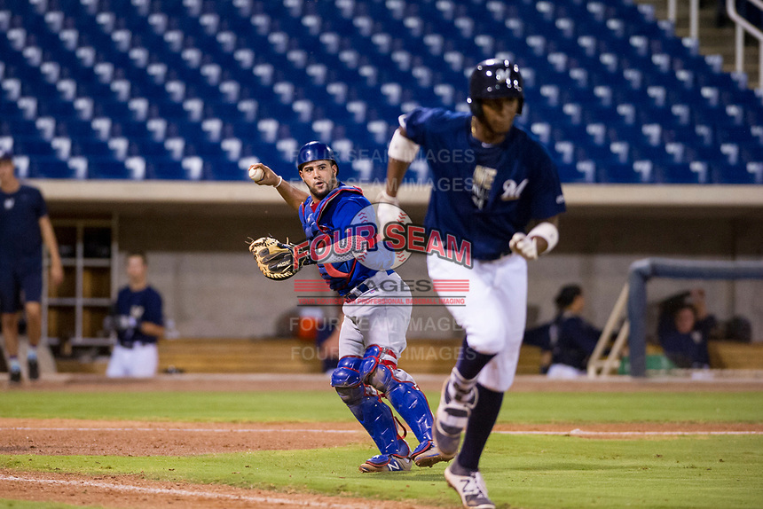 AZL Cubs catcher Richard Nunez (8) prepares to make a throw to first base against the AZL Brewers on August 24, 2017 at Maryvale Baseball Park in Phoenix, Arizona. AZL Cubs defeated the AZL Brewers 9-1. (Zachary Lucy/Four Seam Images)