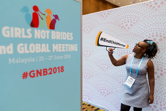 25 June, 2018, Kuala Lumpur, Malaysia : Millicent Ondigo of Kenya enjoying the photo booth at the village during the Girls Not Brides Global Meeting 2018 at the Kuala Lumpur Convention Centre. Picture by Graham Crouch/Girls Not Brides