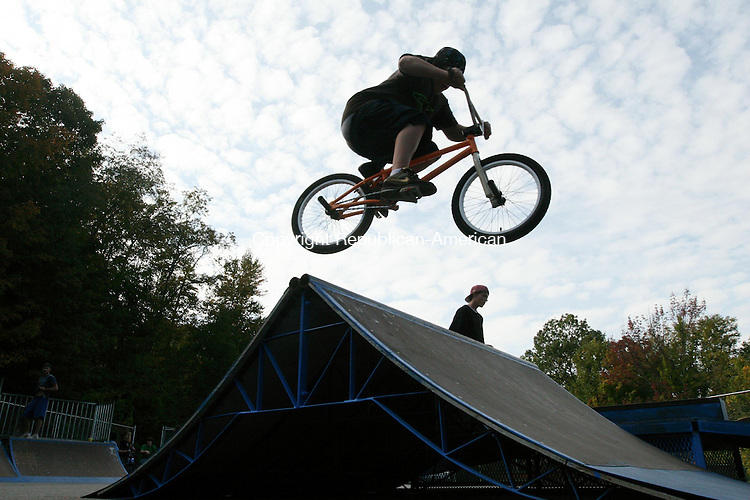 WINSTED, CT - 1 October, 2008 - 100108MO03 - Colebrook resident Dan Hiller, 14, catches some air Wednesday at the Winsted Skate Park, which reopened this week following a three-month effort to repair damaged ramps. Town officials estimate upwards of $5,000 was saved by doing most of the work in-house. About two dozen skaters and bicyclists were using the park Wednesday afternoon. Jim Moore Republican-American.