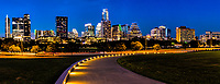 Another image of the Austin skyline after dark as this lighted path leads the way to a view of Austin cityscape as a backdrop in this panorama image.  We like the way the lights on the walkway lead you down the path to this wonderful skyline image of downtown Austin.  The city of Austin has been growing at leap and bound and there are so many new high-rise skycrapers coming to the downtown area.  Most of the new high rise buildings are along Lady Bird lake which makes for some great skyline views. You can still see one of our first high rise buildings the Frost Bank building along with tallest building the Austonian at least for now. The Independence is being built now and will be tallest building but till then the Austonian will have the title.  The architecture of Austin tends to be on the modern side and there are many new building that  are on their way like the Independence or Jingle building which will seem to defy gravity which push the city architecture to be even more of a modern city.