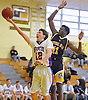 Ryan Prendergast #12 of South Side, left, drives to the net for two points during a non-league game against Central Islip in the Richard Brown Nassau-Suffolk Challenge at Uniondale High School on Saturday, Jan. 14, 2017. South Side won by a score of 67-61.