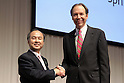 October 15, 2012, Tokyo, Japan - Softbank Corp. President Masayoshi Son (L) shakes hands with Dan Hesse, president and CEO of the Sprint Nextel Corporation, at the end of their media conference in Tokyo on Monday, October 15, 2012. Son announced that Japanese mobile Internet company Softbank has reached a deal to acquire Sprint Nextel Corp., the third-largest mobile carrier in the U.S. for $20 billion. The deal enables Softbank to establish an operating base as one of the largest mobile Internet companies in the world, with combined mobile telecom service revenues that will rank it third amongst global operators. Softbank aims to enhance Sprint's competitiveness in the U.S. and the deal includes $8 billion of new capital for the U.S. carrier. The companies expect the closing of the transaction to occur in mid-2013 pending regulatory approvals. .(Photo by Yusuke Nakanishi/AFLO)