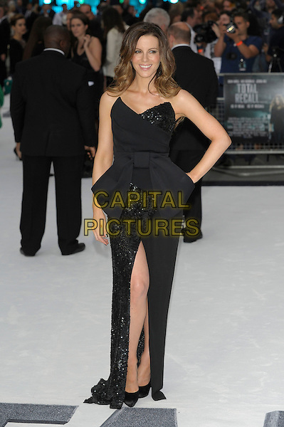 Kate Beckinsale.'Total Recall' UK premiere at Vue cinema, Liecester Square, London, England..16th August 2012.full length black dress strapless sequins sequins bow-cinched waist slit split hand on hip.CAP/PL.©Phil Loftus/Capital Pictures.