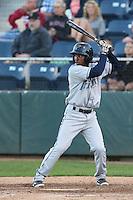 Cesar Galvez #6 of the Tri-City Dust Devils bats against the Everett AquaSox at Everett Memorial Stadium on July 29, 2014 in Everett, Washington. Everett defeated Tri-City, 7-5. (Larry Goren/Four Seam Images)