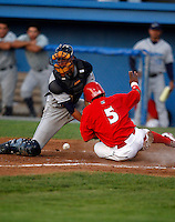 August 13, 2009:  Catcher Dan Killian of the Vermont Lake Monsters loses the ball as Luis De La Cruz slides in during a game at Dwyer Stadium in Batavia, NY.  The Lake Monsters are the Short-Season Class-A affiliate of the Washington Nationals.  Photo By Mike Janes/Four Seam Images
