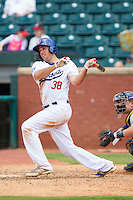 Alex Liddi (38) of the Chattanooga Lookouts follows through on his swing against the Montgomery Biscuits at AT&T Field on July 23, 2014 in Chattanooga, Tennessee.  The Lookouts defeated the Biscuits 6-5. (Brian Westerholt/Four Seam Images)