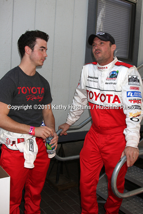 LOS ANGELES - APR 16:  Kevin Jonas, Brian Austin Green  at the Toyota Grand Prix Pro Celeb Race  at Toyota Grand Prix Track on April 16, 2011 in Long Beach, CA.