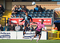 Aaron Holloway of Wycombe Wanderers wins the ball in the air under pressure from Darnell Furlong (Loanee from QPR) of Northampton Town during the Sky Bet League 2 match between Wycombe Wanderers and Northampton Town at Adams Park, High Wycombe, England on 3 October 2015. Photo by Andy Rowland.