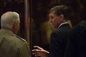 Lieutenant General Michael Flynn (R) and Former Secretary of Defense Robert Gates (L) are seen conversing as they wait for an elevator in the lobby of Trump Tower in New York, NY, USA on December 1, 2016. Credit: Albin Lohr-Jones / Pool via CNP