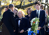 United States President Barack Obama talks with Ethel Kennedy, widow of former Attorney General and U.S. Senator Robert F. Kennedy (Democrat of New York) after laying a wreath at the gravesite for President John F. Kennedy at Arlington National Cemetery in Arlington, Virginia, November 20, 2013. This Friday will mark the 50th anniversary of the assassination of President Kennedy. Jack Schlossberg, son of U.S. Ambassador to Japan Caroline Kennedy and grandson of President Kennedy, looks on from right.<br /> Credit: Pat Benic / Pool via CNP