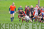 Killarney scrum half Paul O'Sullivan  makes a break for the line against UCC on Sunday