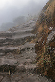 Inca Trail to Machu Picchu, Peru. Andean rocky mountain steps hewn from the rocks by the Incas on a misty morning.