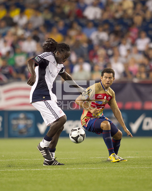 New England Revolution midfielder Shalrie Joseph (21) controls the ball as Monarcas Morelia forward Miguel Sabah (9) defends. Monarcas Morelia defeated the New England Revolution, 2-1, in the SuperLiga 2010 Final at Gillette Stadium on September 1, 2010.