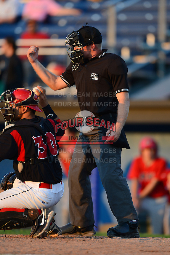Home plate umpire Matt Winters during a NYPL game between the Batavia Muckdogs and State College Spikes on June 29, 2013 at Dwyer Stadium in Batavia, New York.  Batavia defeated State College 5-4.  (Mike Janes/Four Seam Images)