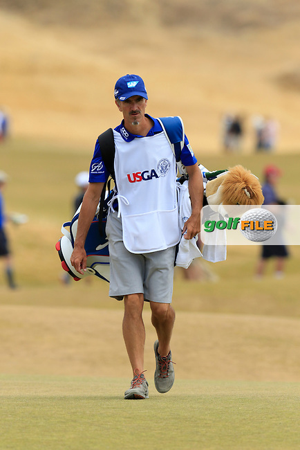 Colin Byrne caddy for Ernie ELS (RSA) walks onto the 5th green during Thursday's Round 1 of the 2015 U.S. Open 115th National Championship held at Chambers Bay, Seattle, Washington, USA. 6/18/2015.<br /> Picture: Golffile | Eoin Clarke<br /> <br /> <br /> <br /> <br /> All photo usage must carry mandatory copyright credit (&copy; Golffile | Eoin Clarke)