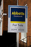 Abbots Countrywide estate agent for sale sign on building, Woodbridge, Suffolk, England