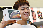 First buyer Mr. Shimizu shows his new iPhone XS Max at the Apple Store in Omotesando on September 21, 2018, Tokyo, Japan. Apple fans lined up patiently in the early morning rain to get the new iPhone models (XS and XS Max) and the new iWatch (Series 4). The new iPhone XS costs JPY 112,800 for the 64 GB model, the iPhone XS Max costs JPY 124,800 JPY for the 64 GB model, and iWatch Series 4 costs JPY 45,800. (Photo by Rodrigo Reyes Marin/AFLO)
