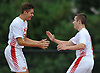 Brendan Slattery #9 of Chaminade, left, gets congratulated by Benjamin Szeremenyi #11 after scoring a goal in the opening minute of a NSCHSAA varsity boys soccer match againt host St. John the Baptist High School on Tuesday, Sept. 11, 2018. Chaminade won by a score of 4-3.