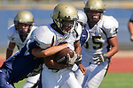Torrance, CA 09/08/11 - Jordan Gates (Peninsula #9) and an unidentified North player in action during the North-Peninsula Junior Varsity Football game at North High School in Torrance.