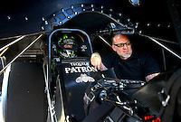 Aug. 16, 2013; Brainerd, MN, USA: NHRA funny car driver Alexis DeJoria (left) sits in the cockpit of her car alongside husband Jesse James during qualifying for the Lucas Oil Nationals at Brainerd International Raceway. Mandatory Credit: Mark J. Rebilas-