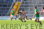 Brendan O'Sullivan South Kerry uses his strength to get past Micheal McCarthy Rathmore during their SFC clash in Fitzgerald Stadium on Sunday