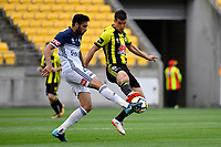 Melbourne Victory&rsquo;s Rhys Willams and Wellington Phoenix&rsquo; Andrija Kaluderovic in action during the A League - Wellington Phoenix v Melbourne Victory FC at Westpac Stadium, Wellington, New Zealand on Sunday 3 December.<br /> Photo by Masanori Udagawa. <br /> www.photowellington.photoshelter.com