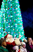 """United States President Barack Obama, accompanied by Marian Robinson, Michelle Obama's mother, left to right, """"Santa Claus"""", and Obama's daughter Sasha, watch during the National Christmas Tree lighting ceremony on the Ellipse near the White House in Washington, DC, on Thursday, December 9, 2010. The first Christmas tree lighting ceremony took place back in 1923, with U.S. President Calvin Coolidge presiding. .Credit: Andrew Harrer / Pool via CNP"""