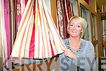 Lorraine Flanagan displays some of the beautiful curtains in the newly refurbished interior design department in Corcoran's furniture Killarney