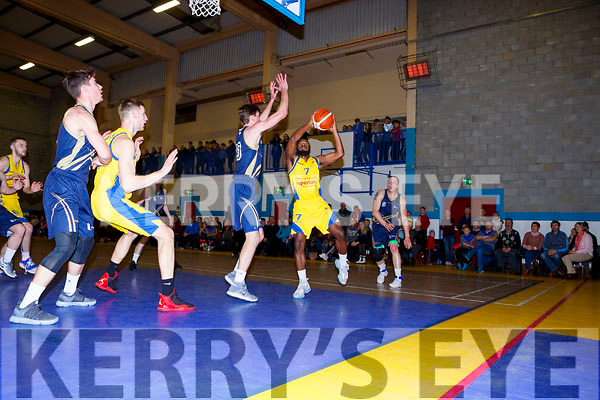 Kevin Gray Keanes SuperValu wrestles the ball away from Adam Ran Ulster Elks during their league clash in Killorglin on Saturday night