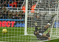 9th November 2019; St James Park, Newcastle, Tyne and Wear, England; English Premier League Football, Newcastle United versus AFC Bournemouth; DeAndre Yedlin of Newcastle United gets tangled in the net after equalising with a header in the 42nd minute to make it 1-1 - Strictly Editorial Use Only. No use with unauthorized audio, video, data, fixture lists, club/league logos or 'live' services. Online in-match use limited to 120 images, no video emulation. No use in betting, games or single club/league/player publications