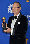 a_Tom Hanks  poses in the press room with awards at the 77th Annual Golden Globe Awards at The Beverly Hilton Hotel on January 05, 2020 in Beverly Hills, California.