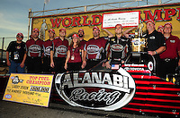 Nov 14, 2010; Pomona, CA, USA; NHRA top fuel dragster driver Larry Dixon celebrates with his team after winning the 2010 top fuel championship during the Auto Club Finals at Auto Club Raceway at Pomona. Mandatory Credit: Mark J. Rebilas-