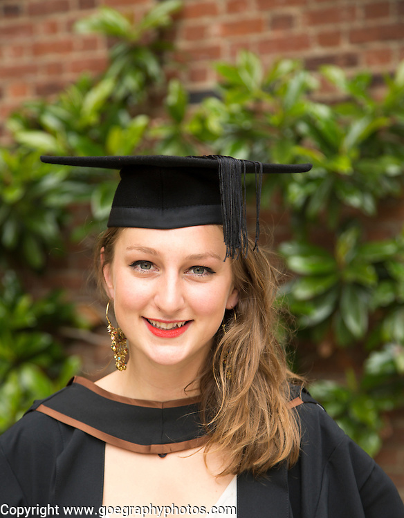 Head and shoulders portrait smiling young woman graduating, Goldsmiths, University of London, England, UK
