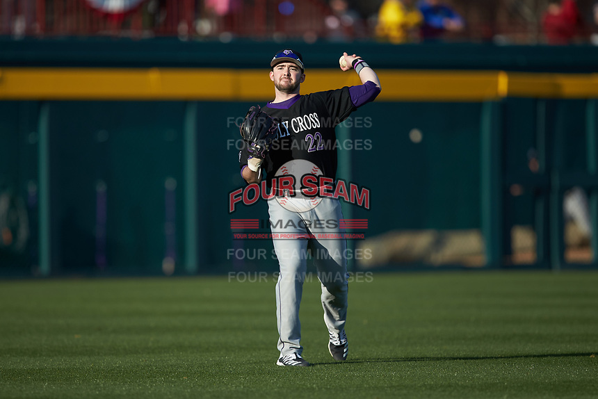 Holy Cross Crusaders left fielder Nate Wolf (22) warms up between innings of the game against the South Carolina Gamecocks at Founders Park on February 15, 2020 in Columbia, South Carolina. The Gamecocks defeated the Crusaders 9-4.  (Brian Westerholt/Four Seam Images)