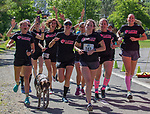 The Eclipse Running team celebrates at the 2019 Reno Tahoe Odyssey finish at Idlewild Park in Reno on Saturday, June 1, 2019.