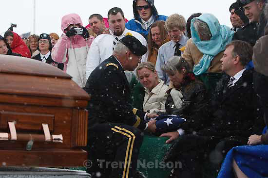 Major General Robert Williams presents a flag to Teena Nemelka, mother of Aaron Nemelka, who was killed in the Ft. Hood massacre and laid to rest at the Utah Veterans Memorial Park, Saturday, November 14 2009. Left of Teena is Aaron's sister-in-law Lindsey Nemelka, to Teena's right is her husband Michael Nemelka.