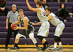SIOUX FALLS, SD - DECEMBER 8:  Jordan Stotts #44 and Tom Aase #14 from the University of Sioux Falls double team Carter Kirk #35 from Southwest Minnesota State Tuesday night at the Stewart Center. (Photo by Dave Eggen/Inertia)