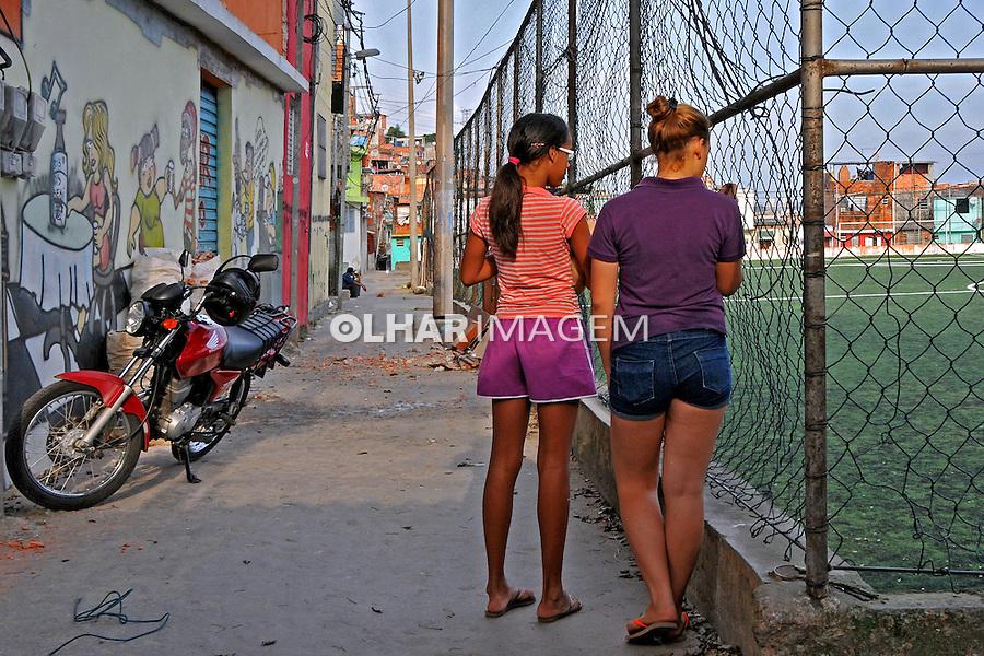 Pessoas na Favela da Erundina. São Paulo. 2014. Foto de Marcia Minillo.