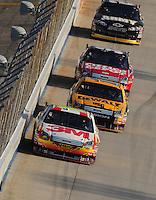Sept. 21, 2008; Dover, DE, USA; Nascar Sprint Cup Series driver Greg Biffle leads teammates Matt Kenseth and Carl Edwards during the Camping World RV 400 at Dover International Speedway. Mandatory Credit: Mark J. Rebilas-