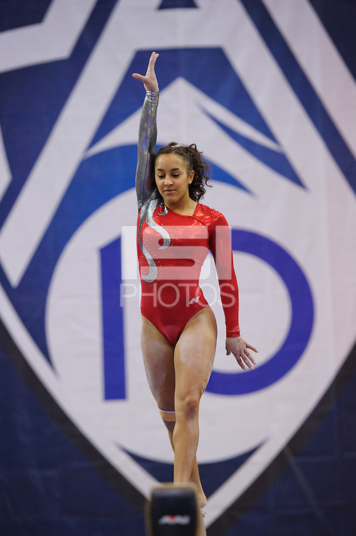 LOS ANGELES, CA - March 19, 2011:  Stanford's Ashley Morgan competes on the balance beam during the Pac-10 Championship at UCLA's Pauley Pavilon.   Stanford placed fourth in the competition.