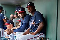 GCL Braves pitchers Chad Bryant (right) and Eudi Asencio (left) in the dugout during a Gulf Coast League game against the GCL Orioles on August 5, 2019 at Ed Smith Stadium in Sarasota, Florida.  GCL Orioles defeated the GCL Braves 4-3 in the second game of a doubleheader.  (Mike Janes/Four Seam Images)