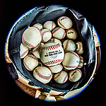 4 September 2017: A bag of NY Penn League Baseballs is ready in the dugout prior to the first game of a double-header against the Tri-City ValleyCats at Centennial Field in Burlington, Vermont. The teams split their day, with Tri-City winning 6-5 in the first game, and the Lake Monsters taking the second 7-4 in NY Penn League action. Mandatory Credit: Ed Wolfstein Photo *** RAW (NEF) Image File Available ***