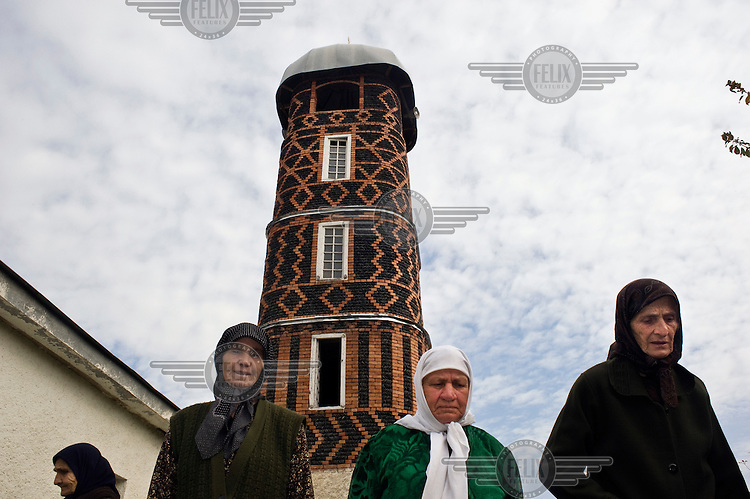 Elderly ethnic Chechen women going home after Friday prayers in the old Duisi Mosque.