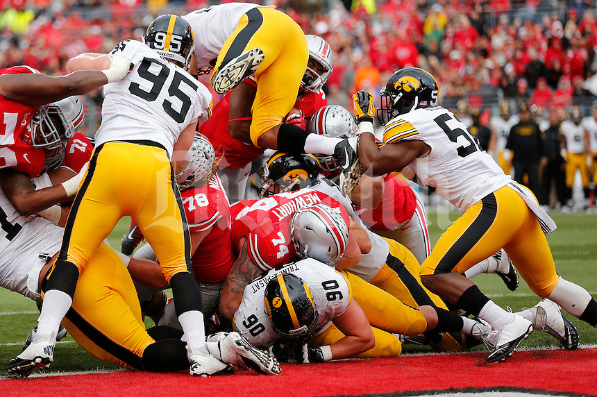 Ohio State Buckeyes running back Carlos Hyde (34) rushes for a touchdown in the third quarter of the NCAA football game between the Ohio State Buckeyes and the Iowa Hawkeyes at Ohio Stadium in Columbus, Saturday afternoon, October 19, 2013. The Ohio State Buckeyes defeated the Iowa Hawkeyes 34 - 24.  (The Columbus Dispatch / Eamon Queeney)