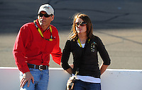 Apr 10, 2008; Avondale, AZ, USA; NASCAR Sprint Cup Series team owner Ray Evernham (left) and Erin Crocker during qualifying for the Subway Fresh Fit 500 at Phoenix International Raceway. Mandatory Credit: Mark J. Rebilas-
